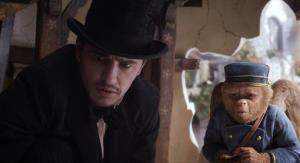 James Franco, as Oz, and Finley, voiced by Zach Braff, in a scene from Oz the Great and Powerful.