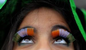 A woman wears false flag eyelashes during the St Patrick's day parade through Dublin city centre on St Patrick's day, Sunday, March 17, 2013.