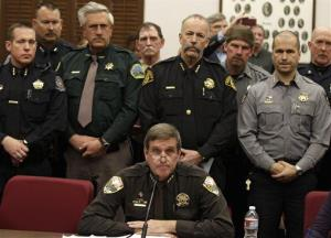 Weld County Sheriff John Cooke, center, backed by a group of fellow sheriffs, in Denver, Monday March 4, 2013.