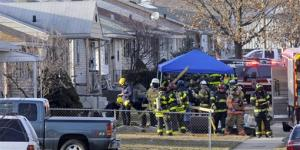 South Bend police and fire officials examine a home where a a plane crash occurred near the South Bend Regional Airport, Sunday, March 17, 2013 in South Bend, Ind.