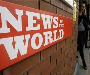 A sign for the News of the World newspaper is seen outside the offices of its owner News International Ltd., in London. in this file photo.
