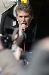 David Hasselhoff speaks to the crowed from a truck as he attends a protest against the removal of a section of the East Side Gallery, a historic part of the former Berlin Wall, March 17, 2013.