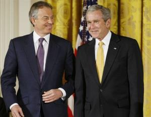 President George W. Bush and former British Prime Minister Tony Blair nudge each other in the East Room of the White House in Washington, Tuesday, Jan. 13, 2009.