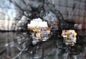 Bullet holes are seen in a window in Tripoli, Lebanon, Saturday, Feb. 11, 2012.