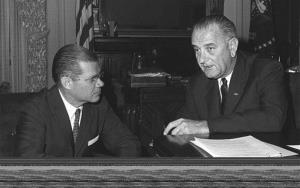 In a November 23, 1963 file photo, President Lyndon B. Johnson confers with Secretary of Defense Robert McNamara.