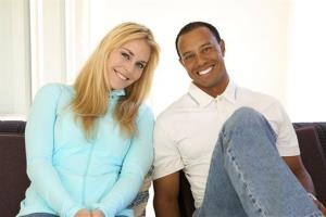 In this 2013 photo provided by Tiger Woods and Lindsey Vonn, golfer Tiger Woods and skier Lindsey Vonn pose for a portrait.