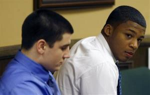 Trent Mays, 17, left, and 16-year-old Ma'lik Richmond sit in court before the start of the third day of their trial on rape charges in juvenile court on Friday, March 15, 2013 in Steubenville, Ohio.