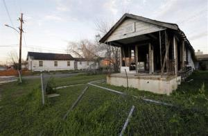 In this Jan. 31, 2013, photo, damaged houses sit vacant in the Lower Ninth Ward of New Orleans, a neighborhood that was hit hard by floodwaters from a levee break after Hurricane Katrina.