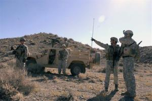 Soldiers from Operational Detachment Alpha 3133 conduct a mounted-dismounted route clearing exercise during a pre-mission training exercise at the Hawthorne, Nev., Army Depot on Oct. 6, 2008.