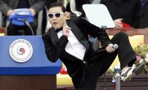 In this Feb. 25, 2013 file photo, South Korean rapper PSY performs before President Park Geun-hye's presidential inauguration ceremony at the National Assembly in Seoul, South Korea.