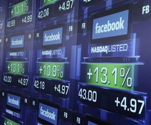 In this Friday, May 18, 2012 file photo, electronic screens show the price of Facebook shares after they began trading in New York.