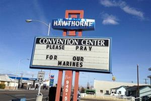 A billboard asks people to pray for the Marines killed in Hawthorne, Nevada, on Monday, March 18, 2013. A mortar shell explosion killed seven Marines during training in Nevada's high desert.