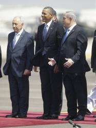 President Barack Obama is greeted by Israeli President Shimon Perez, left, and Israeli Prime Minister Benjamin Netanyahu at Ben Gurion International Airport in Tel Aviv, Israel, March 20, 2013.