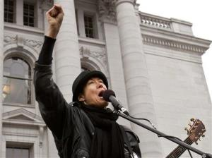 In this 2011 photo, Michelle Shocked performs at the state Capitol in Madison, Wis.