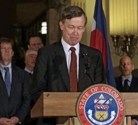 Colorado Gov. John Hickenlooper pauses at a news conference at the Capitol in Denver on Wednesday, March 20, 2013, where he talked about the shooting death of Tom Clements.