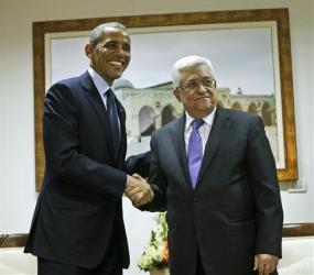 President Obama and Palestinian President Mahmoud Abbas shake hands at the Muqata Presidential Compound in Ramallah, Thursday, March 21, 2013.