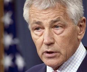Chuck Hagel, seen in this file photo, was one of the leaders of the panel making the report.