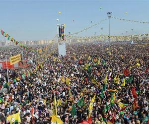 Some thousands of supporters demonstrate waving various PKK flags and posters of jailed Kurdish rebel leader Abdullah Ocalan, in southeastern Turkish city of Diyarbakir, Turkey, March 21, 2013.