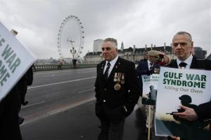 British Gulf War veterans march over Westminster Bridge past the London Eye Ferris Wheel in protest to mark the 20th Anniversary of the end of the first Gulf War in London, Monday, Feb. 28, 2011.