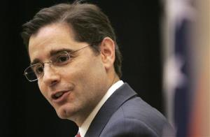 In this Nov. 24, 2009 file photo, Federal Communications Commission Chairman Julius Genachowski speaks at the University of Arkansas Clinton School of Public Service in Little Rock, Ark.