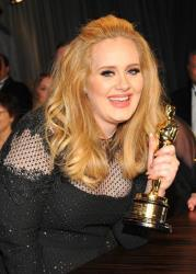 Singer Adele poses with her award for best  original song for Skyfall from the film Skyfall at the Governor's Ball following the Oscars at the Dolby Theatre on Feb. 24, 2013, in Los Angeles.