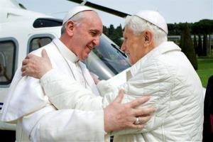 In this photo provided by the Vatican paper L'Osservatore Romano, Pope Francis meets Pope emeritus Benedict XVI in Castel Gandolfo, near Rome.