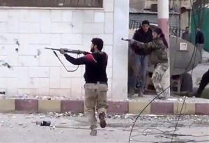 Syrian insurgents fire at Syrian army soldiers during a firefight in Daraa al-Balad, Syria, on March 18.