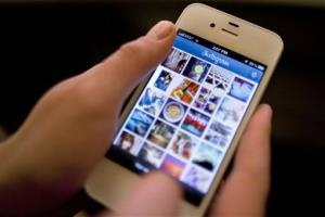 Instagram is demonstrated on an iPhone Monday, April 9, 2012, in New York.