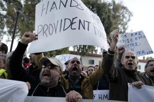 Bank employees, thousands of whom stand to lose their jobs, protest outside the ministry of finance in Nicosia on the weekend.