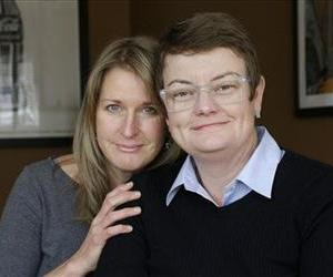 This Feb. 8, 2013 photo taken shows Sandy Stier, left, and Kris Perry, the couple at the center of the Supreme Court's consideration of gay marriage, at their home in Berkeley, Calif.