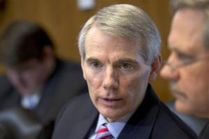 Senate Energy Committee member Sen. Rob Portman sits in on the committee's discussion on the nomination of Sally Jewell to be secretary of the Interior, Thursday, March 21, 2013, on Capitol Hill.