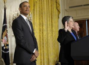 President Barack Obama listens as Homeland Security Secretary Janet Napolitano delivers the oath of allegiance during a naturalization ceremony, March 25, 2013, at the White House in Washington.