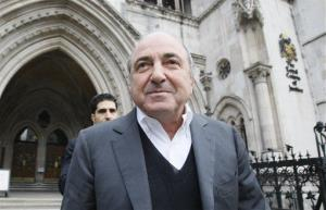 In this Wednesday, March, 10, 2010 file photo, self-exiled oligarch Boris Berezovsky leaves the High Court in London.