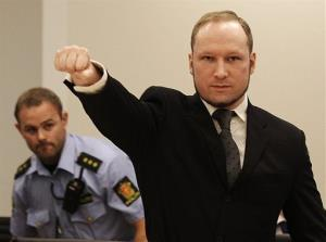 In this Aug. 24, 2012 file photo, mass murderer Anders Behring Breivik, makes a salute after arriving in the court room at a courthouse in Oslo.