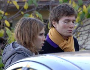 This Nov. 2, 2007 photo shows Amanda Knox and her then-boyfriend Raffaele Sollecito outside the rented house where 21-year-old British student Meredith Kercher was found dead in Perugia, Italy.