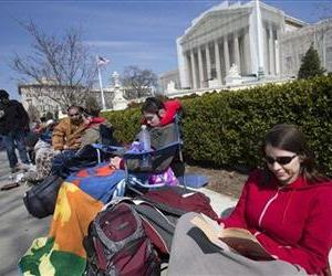 People wait in line outside of the US Supreme Court in Washington in anticipation of Tuesday's Supreme Court hearing on California's Proposition 8 ban on same-sex marriage, March 23, 2013.