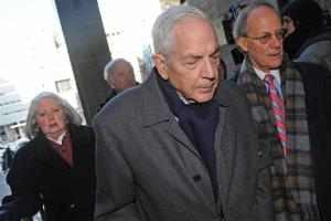 Anthony Marshall, center, arrives at Manhattan State Supreme Court for his sentencing with his wife Charlene, left, and his attorney Ken Warner, right, Monday, Dec. 21, 2009, in New York.
