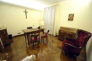 This photo provided by the Vatican newspaper L'Osservatore Romano shows the study in the suite where Francis is living.