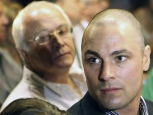 In this Feb. 19, 2013 file photo, Carl Pistorius, and Henke Pistorius attend Oscar Pistorius' bail hearing at the magistrate court in Pretoria, South Africa.