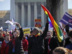 Demonstrators chant outside the Supreme Court in Washington, Tuesday, March 26, 2013.