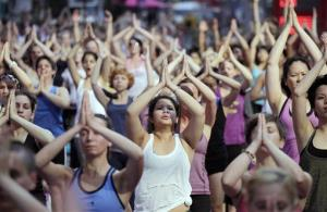Thousands of yoga enthusiasts convene in New York's Times Square to mark the summer solstice, Wednesday, June 20, 2012. Temperatures are expected to be near 100 degrees (37C) Wednesday.