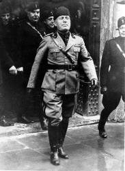 In this April 21, 1936 file photo Benito Mussolini walks in the rain during the 2,698th anniversary of the birth of Rome.