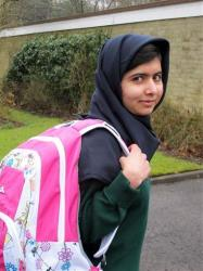 Image made available by her press office of Malala Yousafzai, the Pakistani schoolgirl shot in the head by the Taliban, as she attends her first day of school on Tuesday March 19, 2013.
