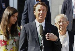In a  Thursday, May 31, 2012 file photo, John Edwards speaks outside a federal courthouse as his daughter, Cate Edwards, left, and father Wallace Edwards, listen.