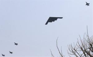 U.S. Air Force B-2 stealth bomber flies over near Osan U.S. Air Base in Pyeongtaek, south of Seoul, South Korea, Thursday, March 28, 2013.