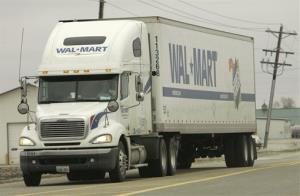 A Wal-Mart truck makes its way down a local highway, in this Nov. 30, 2006 file photo, in Mt. Pleasant, Iowa.