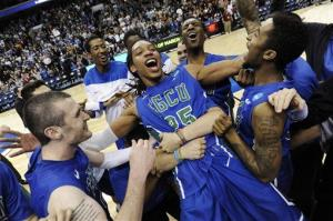 Florida Gulf Coast's Sherwood Brown, center, celebrates with teammates after their third-round win in the NCAA tournament. They play Florida Friday night.