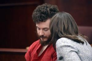 Defense attorney Tamara Brady talks to defendant James Holmes during his arraignment in Centennial, Colo., on Tuesday, March 12, 2013.