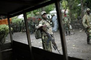 In this Dec. 1, 2012 file photo, M23 rebels withdraw from the eastern Congo town of Goma.
