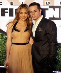 Jennifer Lopez and Casper Smart arrive at Muhammad Ali's Celebrity Fight Night XIX at the JW Marriott Desert Ridge Resort and Spa, Saturday, March 23, 2013, in Phoenix.